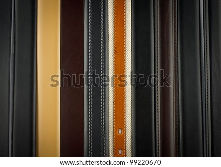 Background with man belts - stock photo