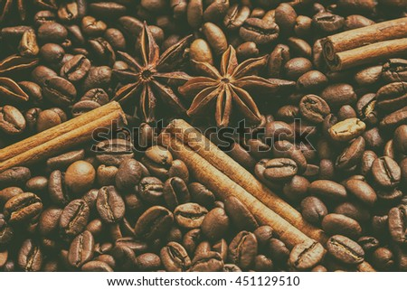 Background with many coffee beans. The effect of film grain. Cinnamon and star anise. - stock photo