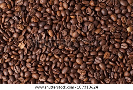 Background with many roasted coffee beans - stock photo