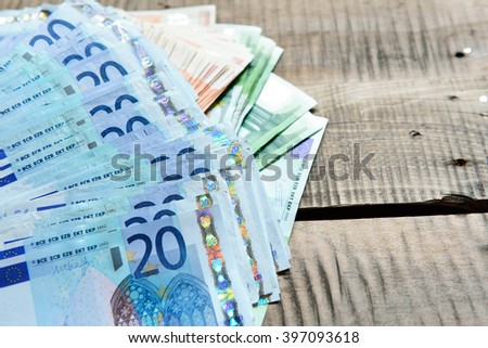 Background with money. Euro cash over wooden background. - stock photo