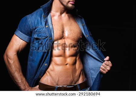 Background with muscular and sexy body of young man in jeans shirt - stock photo
