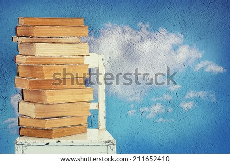 Background with old books and chair - stock photo