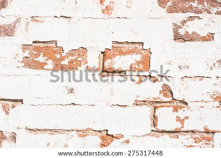 background with old rough antique brick wall terracotta brick with cracks and splits - stock photo