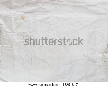 Background with old, rumpled and a shabby paper - stock photo