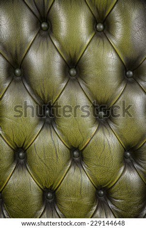 background with olive color chesterfield leather - stock photo