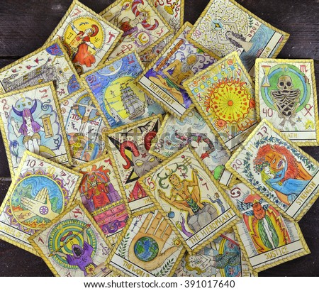 Background with pile of the tarot cards, the major arcana deck.  Fortune telling seance or black magic ritual. Scary still life with occult and esoteric symbols. Halloween or divination rite - stock photo
