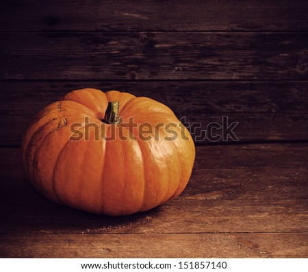 background with pumpkin on wooden board