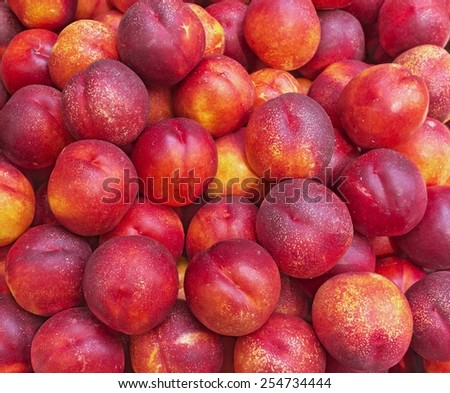 Background with ripe red peaches - stock photo