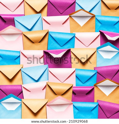 Background with rows of colorful envelopes, Pink, blue and brown envelope collection.  - stock photo