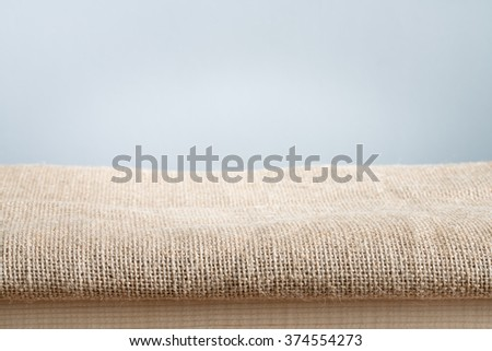 Background with sack cloth on wooden deck table use for product display