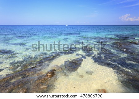 background with sea beach. wooden boat Adaman sea in Thailand.