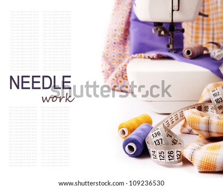 Background with sewing tools and colored fabric - stock photo