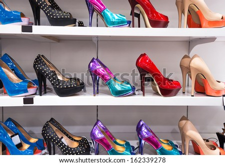 Background with shoes on shelves of shop - stock photo