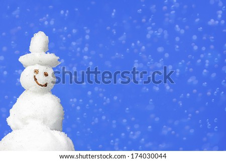 background with smiling snowman and blur, copy space - stock photo
