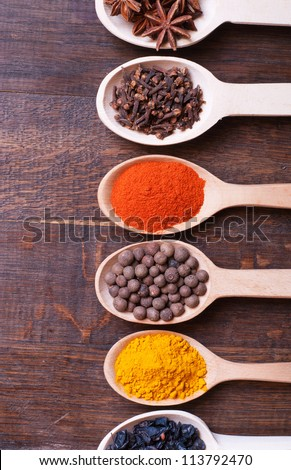 Background with spices ( turmeric , star anise , barberry , allspice , cloves , paprika) - stock photo