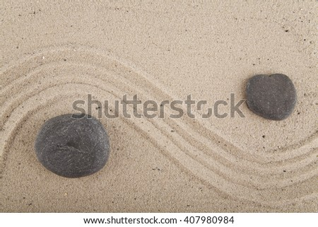 background with stones and sand for meditation and relaxation to find spiritual balance and purity, on sand background - stock photo