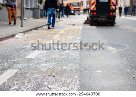 Background with street sweeper machines cleaning the street after a carnival party. Selective focus in the foreground.  - stock photo