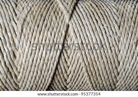 background with string wrapped on roll - stock photo