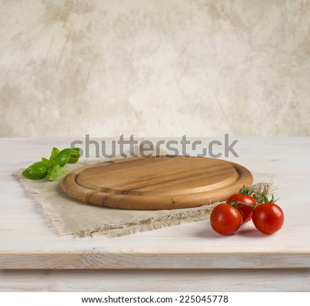 Background with table and kitchen board over vintage wall background - stock photo