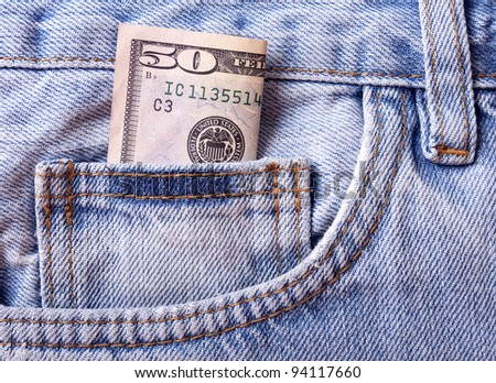 background with the blue jeans pocket with money in it - stock photo