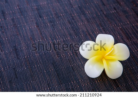 Background with the flower shaped aroma candle - stock photo