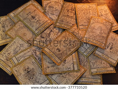 Background with the tarot cards. Halloween and magic still life, fortune telling seance or black magic ritual with mysterious occult and esoteric symbols, divination rite  - stock photo