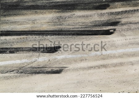 Background with tire marks on road track - stock photo
