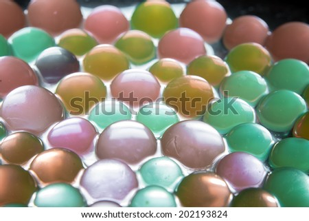 Background with transparent colored beads closeup
