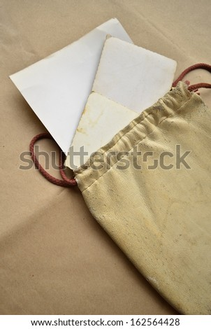 Background with vintage leather bag with old papers