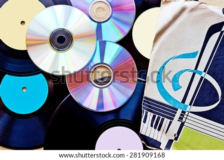 Background with Vinyl record discs ans CD. Top view - stock photo