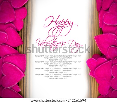 Background with white paper heart and purple hearts on wooden desk with white copy space - stock photo