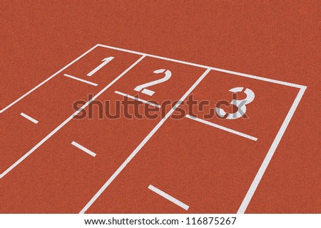 Background with white starting line on red clay