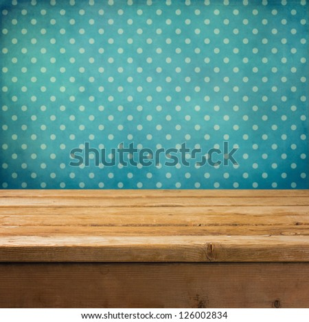 Background with wooden deck table and vintage polka dots wallpaper - stock photo