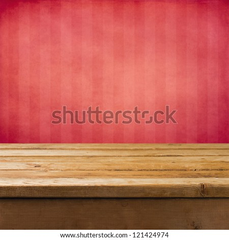 Background with wooden table and pink grunge striped wall - stock photo