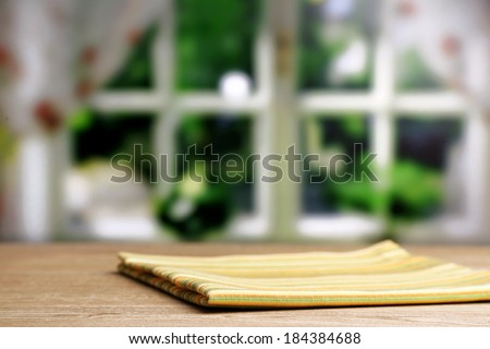 Background with wooden table and tablecloth - stock photo