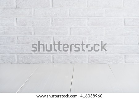 Background with wooden white table and brick wall