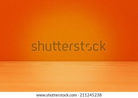 Background with yellow wooden table and orange wall
