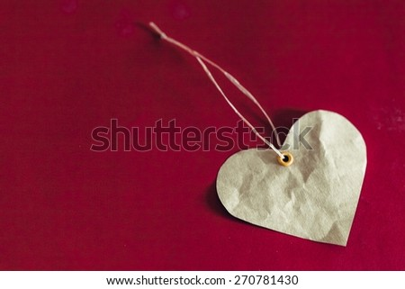 Background. Wooden heart on a red background - stock photo