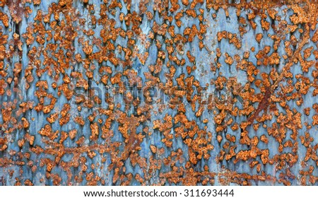 Backgrounds and textures: old cracked paint on rusty metal surface, industrial abstract - stock photo