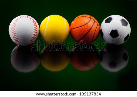 Backgrounds with assortment of sport balls - stock photo