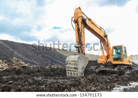 Backhoe and Coal Seam in open pit