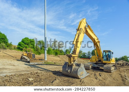 Backhoe Clearing a Building Site - stock photo
