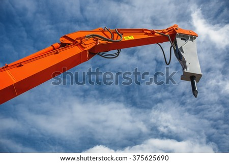 Backhoe loader or bulldozer - excavator and blue sky - stock photo