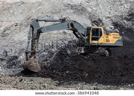 backhoe working In coal mines. - stock photo