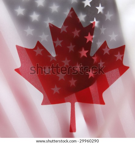 backlit flags of Canada and the USA - stock photo