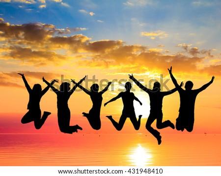 Backlit Group Evening Celebration  - stock photo