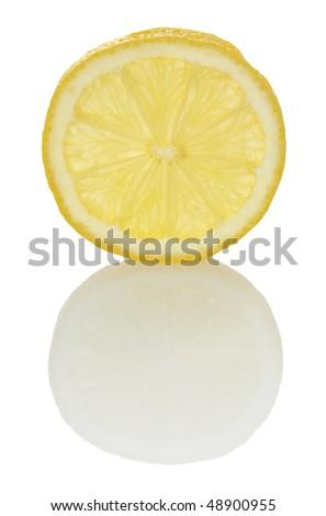 backlit lemon slice and faint reflection isolated on white - stock photo