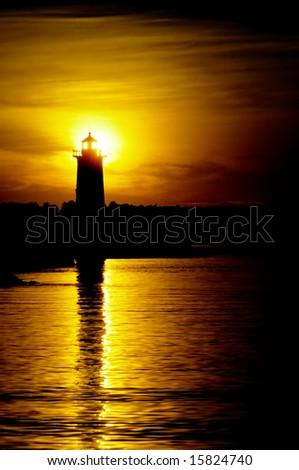 Backlit lighthouse - stock photo