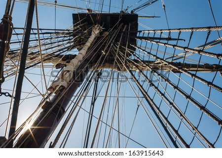 backlit mainmast of replica ship