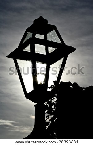 backlit silhouette of lantern - stock photo